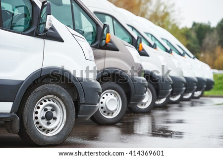 transporting service company. commercial delivery vans in row  - stock photo