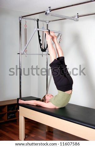Trapeze Table Pilates Excercise - stock photo
