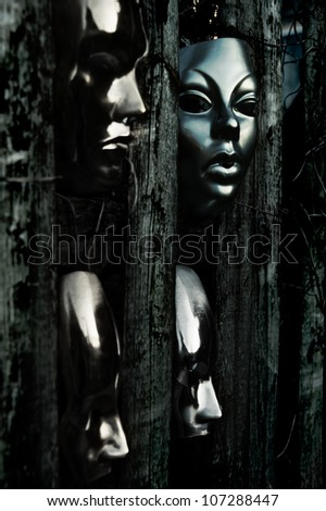Trapped - Masks behind Weathered Fence