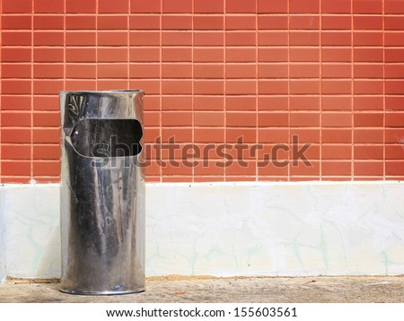 trash and red wall background