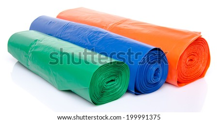 Trash bags in blue, orange and green, isolated on white - stock photo