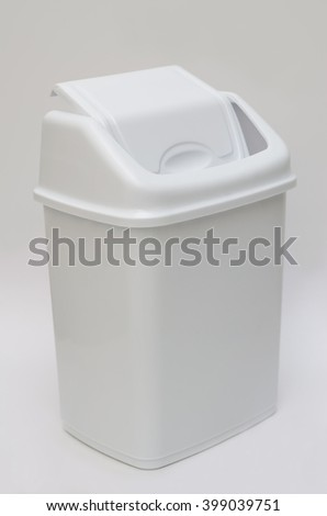 Trash bin with hinged lid - stock photo