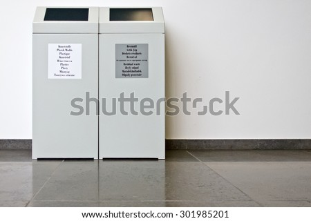 Trash bins to separate waste in a public building, copy-space  - stock photo