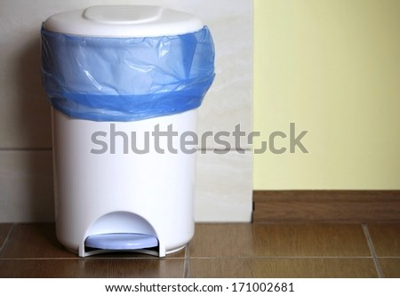 trash can with a plastic bag inside indoor - stock photo