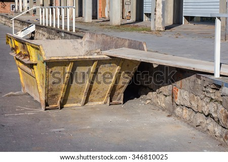 Trash container for concrete debris. Construction waste container. Made with shallow dof. - stock photo