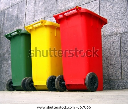 Trash Containers for Garbage Separation -- three colors for plastic, metal and burnables - stock photo