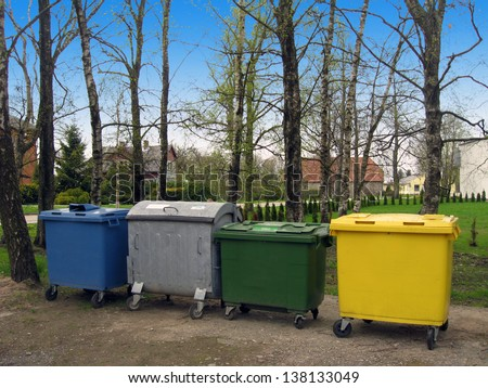 Trash containers in different color, for sorted waste - stock photo