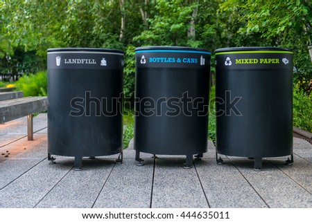 trash containers on city street. Colorful metal containers in a row for separate garbage trash collection with signs. - stock photo
