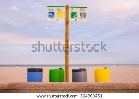 trash cubes in beach - stock photo