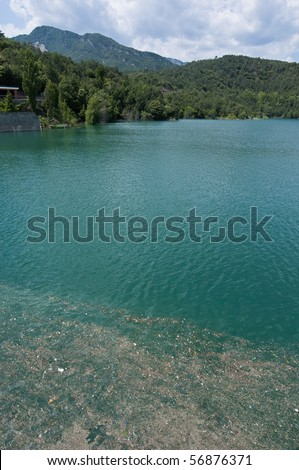 Trash floating on contaminated waters - stock photo