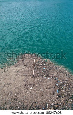 Trash floating onn contaminated waters - stock photo
