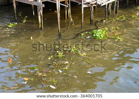 Trash in Bangkok river - stock photo