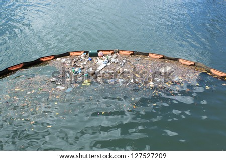 Trash in the water with Barrier - stock photo