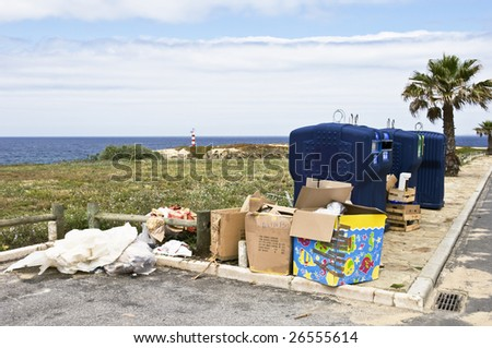 Trash neglectfully abandoned near recycle containers - stock photo