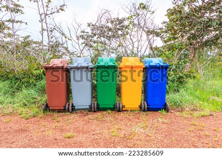Trash recycling container ecology concept, with landscape backgr