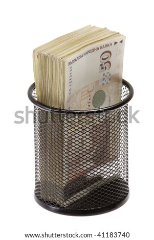 Trash with banknotes as metaphor - stock photo