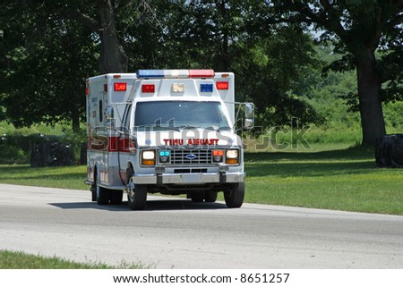 Trauma Unit Ambulance on wooded country road emergency vehicle - stock photo