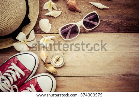Travel accessories for summer on wooden background - stock photo