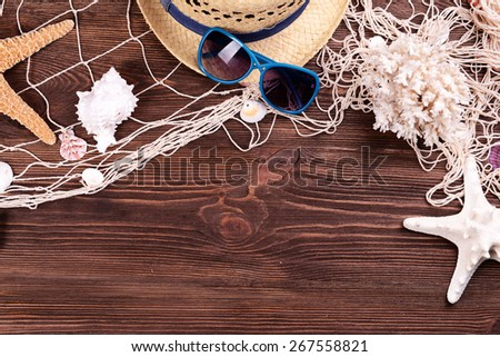 Travel accessories on wooden background - stock photo
