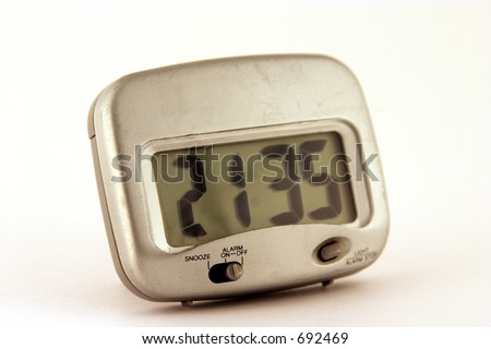 Travel alarm clock on white background