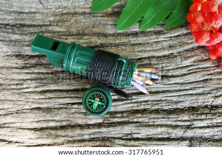 Travel and survival gear. Whistle and compass - stock photo