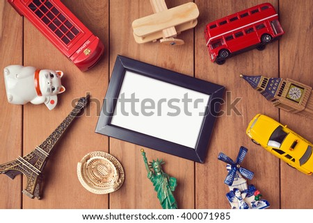 Travel and tourism concept with frame mock up template and souvenirs from around the world. View from above - stock photo