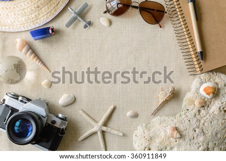 Travel and vacation accessories on sackcloth background, Summer concept with copy space - stock photo
