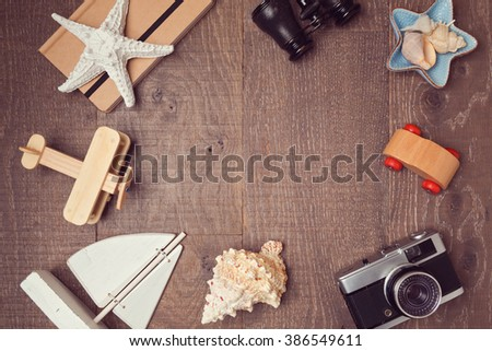 Travel and vacation concept background on wood. View from above. Flat lay - stock photo