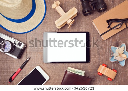 Travel and vacation concept background with digital tablet mock up and objects. View from above - stock photo
