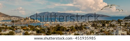 Travel and vacation on Aegean Sea - leisure and yachting on Turkish Riviera. Marine landscape with yachts in a Bodrum harbor - panorama of seascape with island on a horizon.  - stock photo