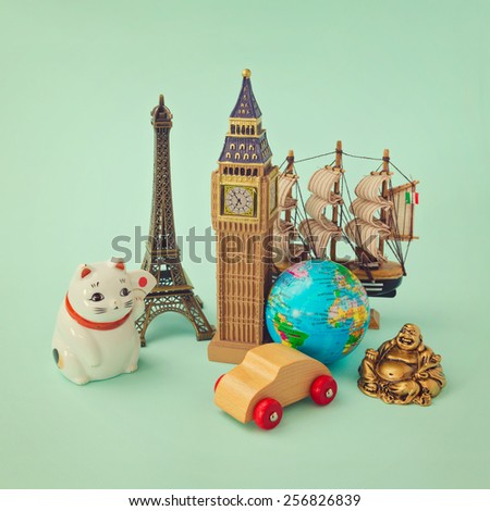 Travel around the world concept. Souvenir form around the world. Retro filter effect - stock photo