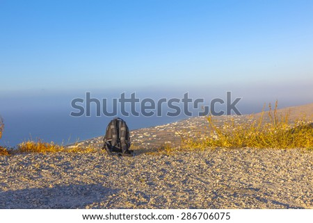 Travel back bag on a mountain during an adventure - stock photo