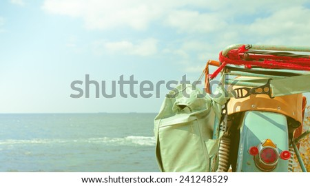 travel background - sea, vintage motorcycle and clouds - stock photo