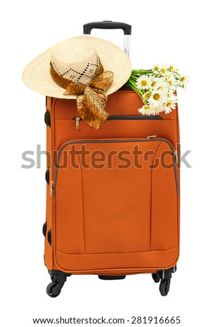 Travel bag with a straw hat and a bouquet of daisies - stock photo