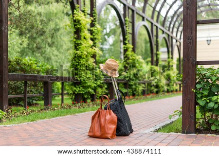 Travel bags and hat, summer traveling and holiday concept. Suitcase and accessories - stock photo