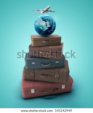 travel bags with earth and airplane - stock photo