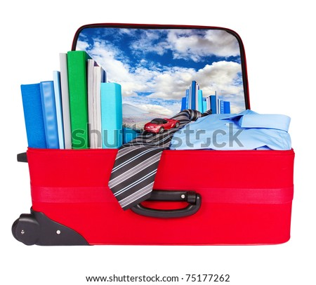 Travel blue business suitcase. Packed for official journey. Personal belongings: books, tie, shirt, toothbrush - stock photo