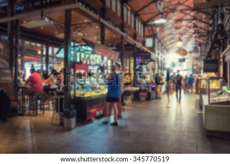 Travel blurred backgrounds - Mercado San Miguel in Madrid, Spain - one of the most popular places in the city. Different food stalls, drinks, seafood - stock photo
