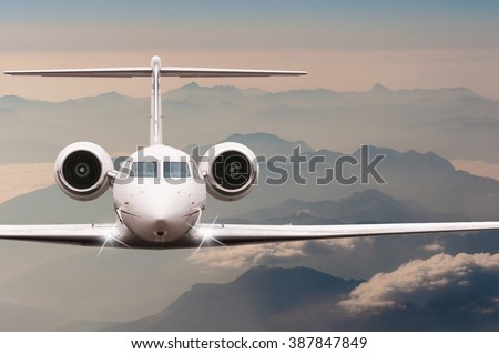 Travel by aircraft. Airplane fly over clouds and Alps mountain on down. Front view of a big passenger or cargo plane, business jet, airline. Transportation concept. Empty space for text - stock photo