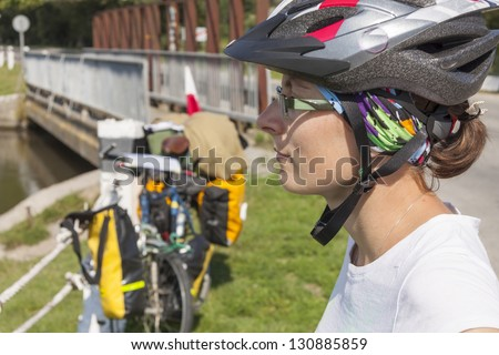 Travel by bicycles - women face with  Sports helmet on the head. Ukraine , Europe.