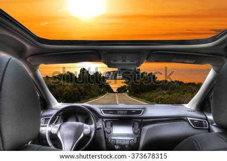 travel by car to the beach - stock photo