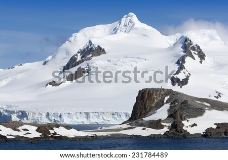 Travel by the research ship. Studying of colonies of penguins and weather in Antarctica. Snow and ices of the Antarctic islands.  - stock photo