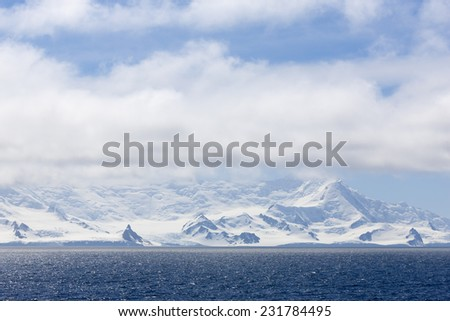Travel by the research ship. Studying of colonies of penguins and weather in Antarctica. Snow and ices of the Antarctic islands.