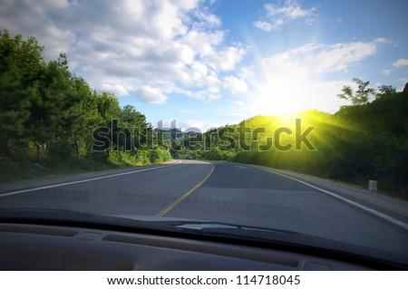 Travel car road sun - stock photo
