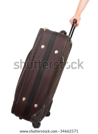 Travel case and hand isolated - stock photo