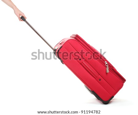 Travel case and hand isolated on white - stock photo