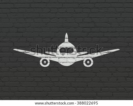 Travel concept: Aircraft on wall background - stock photo
