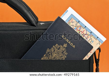 Travel concept: Canadian passport, map and suitcase. - stock photo