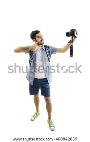 Travel concept. Full length studio portrait of handsome young man taking selfie. Isolated on white background   - stock photo