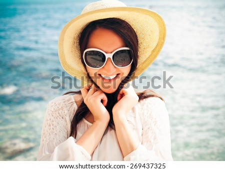 travel concept - Happy woman in hat on the beach - stock photo